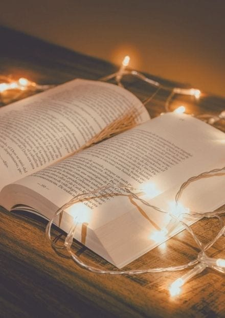 open books with fairy lights